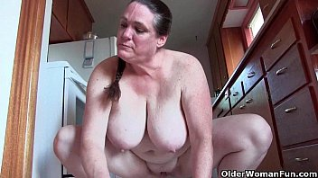 ornhub Granny with big tits cleaning the kitchen naked