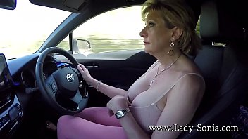 tnaflix Mature blonde Lady Sonia plays with her tits while driving