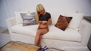 purecfnm Natural busty blonde playing with toy on couch