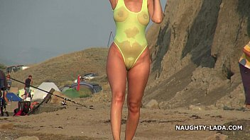 porn4k Transparent swimsuit and nude on the beach