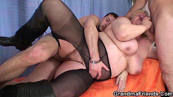video9 com Busty granma in stockings takes two cocks