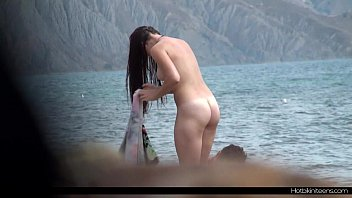 x      Nude Couple At The BEach