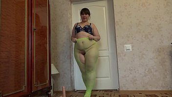 exvideos A fat girl with a big ass and a hairy pussy in green pantyhose masturbates her p