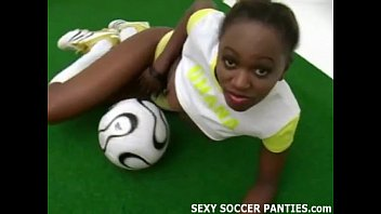 xart Beautiful African football babe doing a striptease