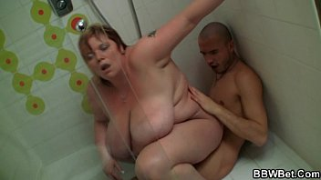 bigporn Huge titted lady rides in the shower